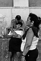 Brazilian people drink cachaca liquor in the port of Manaus, an industrial hub deep in the Amazon jungle of Brazil, 15 April 2004. Amazonia is the world's largest dense tropical forest area. Since the 16th century the original indigenous people have been virtually pushed away or exterminated. The primal ancient unity between tribes and the jungle ambient has changed into a fight between the urban based civilization and the jungle enviroment. Although new generations of white and mestizo settlers have not become adapted to the wild tropical climate and rough conditions, they keep moving deeper into the virgin forest. The technological expansion causes that Amazonia is changing rapidly.