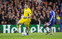 Goalkeeper Iker Casillas of FC Porto takes the ball past goalscorer Willian of Chelsea during the UEFA Champions League group G match between Chelsea and FC Porto at Stamford Bridge, London, England on 9 December 2015. Photo by Andy Rowland.