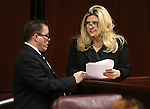 Nevada Assembly Republicans John Moore and Michele Fiore work on the Assembly floor at the Legislative Building in Carson City, Nev., on Tuesday, March 3, 2015. <br /> Photo by Cathleen Allison