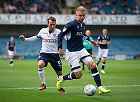 Millwall's Byron Webster holds off the challenge from Bolton Wanderers' Adam Le Fondre<br /> <br /> Photographer Ashley Western/CameraSport<br /> <br /> The EFL Sky Bet Championship - Millwall v Bolton Wanderers - Saturday August 12th 2017 - The Den - London<br /> <br /> World Copyright &not;&copy; 2017 CameraSport. All rights reserved. 43 Linden Ave. Countesthorpe. Leicester. England. LE8 5PG - Tel: +44 (0) 116 277 4147 - admin@camerasport.com - www.camerasport.com