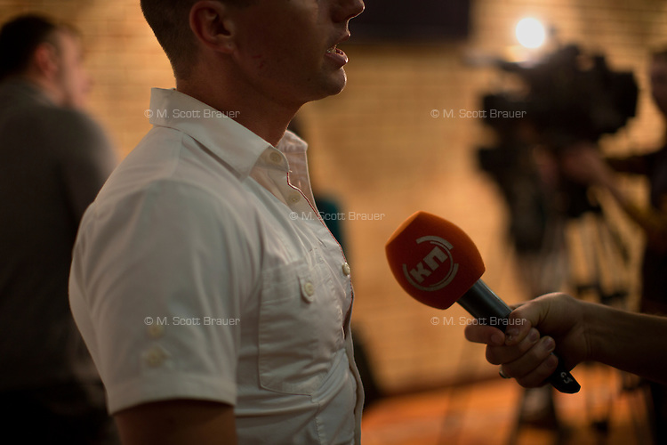 A Komsomolskaya Pravda reporter records an interview with Italian artist Michele Ceppi during an opening of his work 7 Deadly Sins in Moscow, Russia.