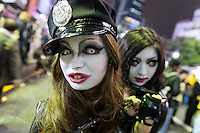 Two Japanese woman dressed as sexy police officers during the Halloween celebrations in Shibuya, Tokyo, Japan. Saturday October 29th 2016 Halloween celebration in Japan have grown massively in the last few years. To ensure the safety of the crowds in Shibuya this year, the police closed several roads leading to the famous Hachiko Square, allowing costumed revellers to spread over a larger area.