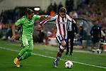 Atletico de Madrid´s Griezmann and Juventus´s Martin Caceres during Champions League soccer match between Atletico de Madrid and Juventus at Vicente Calderon stadium in Madrid, Spain. October 01, 2014. (ALTERPHOTOS/Victor Blanco)