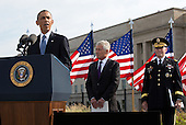 United States President Barack Obama speaks during a ceremony at the Pentagon to mark the 13th anniversary of the September 11th, 2001 terrorist attacks, in Washington, Thursday, September 11, 2014. Shown with the president are U.S. Secretary of Defense Chuck Hagel (center) and the Chairman of the Joint Chiefs of Staff, General Martin E.  Dempsey, U.S. Army.<br /> Credit: Martin Simon / Pool via CNP