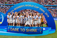 LYON,  - JULY 7: Megan Rapinoe #15 and the USWNT wait for the trophy during a game between Netherlands and USWNT at Stade de Lyon on July 7, 2019 in Lyon, France.