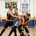 WATERBURY,  CT-021819JS18-  Holy Cross' Jenna Mowad (12) fights to keep the ball with Watertown's Cayla D'Elia (1) and Alyssa Santangeli (14) during their NVL semi-final game Monday at Kennedy High School in Waterbury. <br /> Jim Shannon Republican American