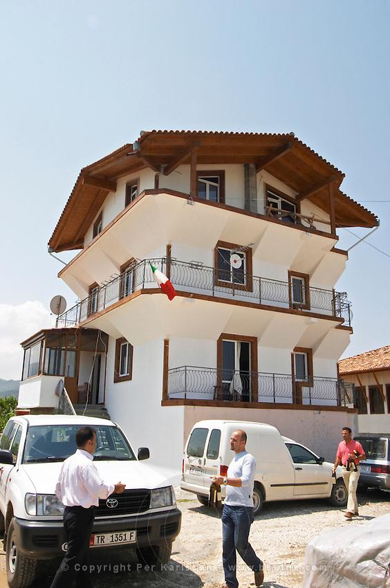 The house where the Cobos live, three story white house typical of the Berat region. Cobo winery, Poshnje, Berat. Albania, Balkan, Europe.