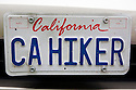 Close Up of 'CA HIKER' (California Hiker) personalized license plate on a Honda Accord car. The Bay Area couple who own the vehicle, you guessed it, love to hike. People pay for the customized plates and the proceeds support various causes. The fees collected for these white custom plates go to support environmental programs in California.