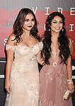 LOS ANGELES, CA - AUGUST 30: Actresses Stella Hudgens (L) and Vanessa Hudgens arrive at the 2015 MTV Video Music Awards at Microsoft Theater on August 30, 2015 in Los Angeles, California.