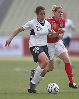 January 28, 2007:  USWNT forward (26) Casey Nogueira sprints past England's (10) Kelly Smith during the Four Nations Tournament held at Guangdong Olympic Stadium in Guanzhou, China.  The USWNT tied England, 1-1.