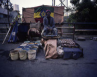 A shoe shiner prepares his stand for business on a sidewalk of the Piazza neighborhood of Ethiopia's capital Addis Ababa on Friday  October 30, 2009.