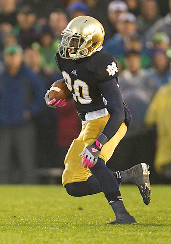 October 13, 2012:  Notre Dame running back Cierre Wood (20) runs for yardage during NCAA Football game action between the Notre Dame Fighting Irish and the Stanford Cardinal at Notre Dame Stadium in South Bend, Indiana.  Notre Dame defeated Stanford 20-13.