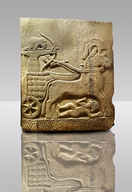 Picture & image of a Neo-Hittite orthostat with a chariot Releif sculpture from Karkamis,, Turkey. Museum of Anatolian Civilisations, Ankara. The Cahiot is pulled by horses with plumed headresses. One man os about to shoot an arrow from his bow, the other man is driving the cahriot. Below the horse is a man dying. 2