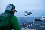 A helicopter takes off from the flight deck of the USNS Comfort, a naval hospital ship, as it makes its way to Haiti to help earthquake survivors on Saturday, January 16, 2010 in the Chesapeake Bay..