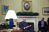 Prime Minister Narendra Modi (L) speaks as United States President Barack Obama (R) listens during an Oval Office meeting at the White House September 30, 2014 in Washington, DC. The two leaders met to discuss the U.S.-India strategic partnership and mutual interest issues.  <br /> Credit: Alex Wong / Pool via CNP