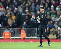 30th November 2019; Anfield, Liverpool, Merseyside, England; English Premier League Football, Liverpool versus Brighton and Hove Albion; Liverpool goalkeeper Alisson walks from the pitch after being shown a red card for intentional handball outside the box  - Strictly Editorial Use Only. No use with unauthorized audio, video, data, fixture lists, club/league logos or 'live' services. Online in-match use limited to 120 images, no video emulation. No use in betting, games or single club/league/player publications