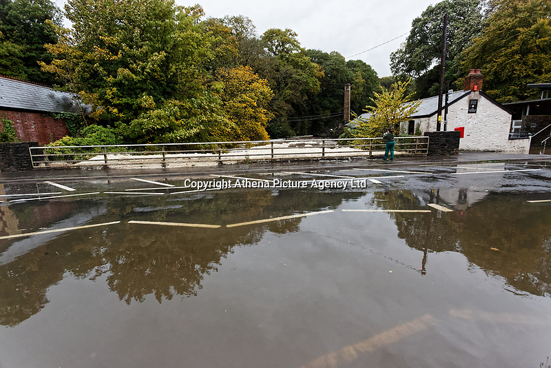 Pictured: The flooded A4119 outside Aberdulais Falls in south Wales, UK. Saturday 13 October 2018<br /> Re: Flooding caused by Storm Callum in Aberdulais near Neath, south Wales, UK.