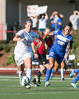 In a National Women's Soccer League Elite (NWSL) match, the Boston Breakers defeated the FC Kansas City, 1-0, at Dilboy Stadium on August 10, 2013.  FC Kansas City forward Lauren Holiday (12) dribbles the ball across the field with Boston Breakers forward Lianne Sanderson (10) in pursuit.