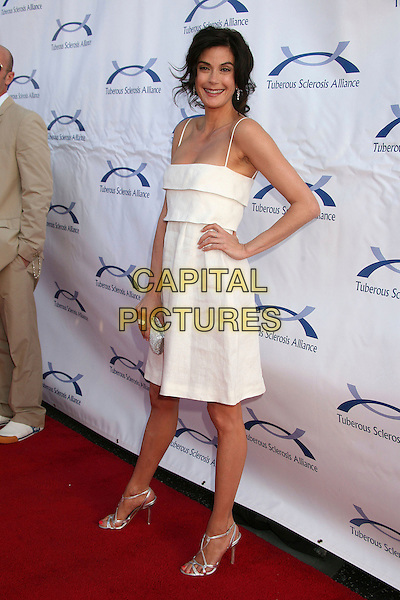 TERI HATCHER.6th Annual Comedy For A Cure at The Music Box Theatre, Hollywood, California, USA..April 1st, 2007.full length white dress hand on hip silver shoes  .CAP/ADM/BP.©Byron Purvis/AdMedia/Capital Pictures