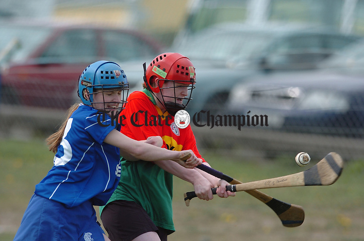 Scariff's Sinead Flaherty blocks Castlecomer's Marie Dollard down during the All-Ireland colleges Junior B camogie final in Mountmellick. Photograph by John Kelly...