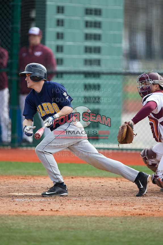 Nate Langhals (6) of the Toledo Rockets follows through on his swing against the Virginia Tech Hokies at The Ripken Experience on February 28, 2015 in Myrtle Beach, South Carolina.  The Hokies defeated the Rockets 1-0 in 10 innings.  (Brian Westerholt/Four Seam Images)