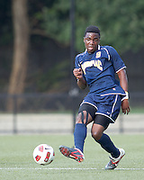 Quinnipiac University midfielder Willya Mekolo (9) passes the ball. Boston College defeated Quinnipiac, 5-0, at Newton Soccer Field, September 1, 2011.