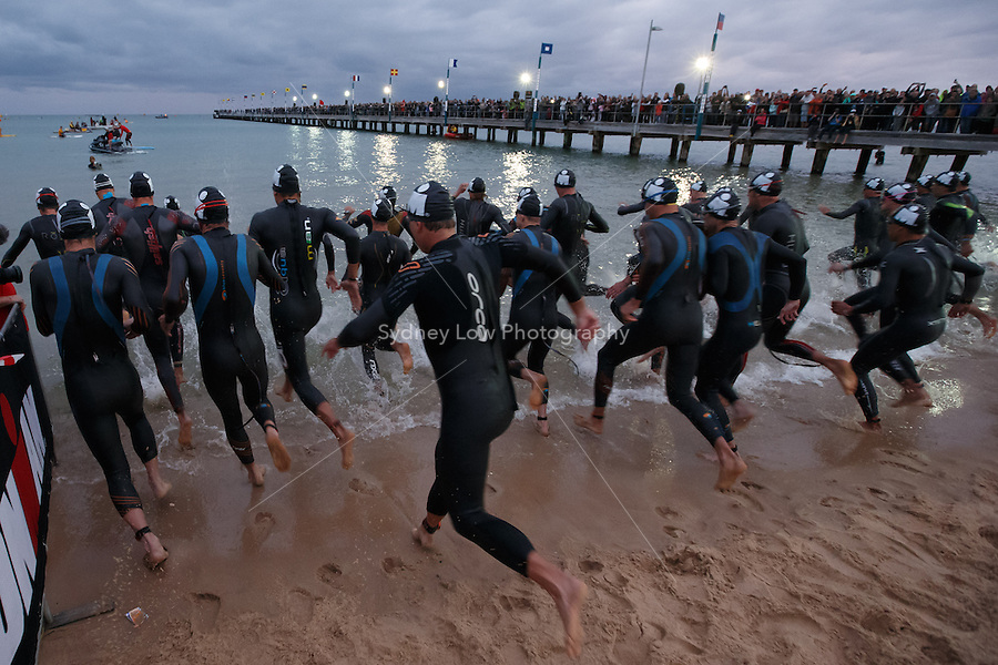 The Pro-Men racers start the swim leg at the IRONMAN Asia-Pacific Championship in Melbourne, Australia on Sunday March 23, 2014. (Photo Sydney Low / sydlow.com)