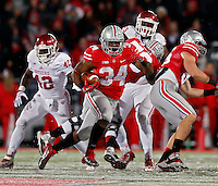 Ohio State Buckeyes running back Carlos Hyde (34) carries the ball up field against Indiana Hoosiers during the third quarter of their college football game at Ohio Stadium in Columbus, Ohio on November 23, 2013.  (Dispatch photo by Kyle Robertson)