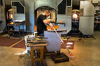 Glassblower working on a piece.