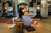 Glassblower working on a piece.