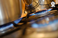 Pan on gas hob, close-up (tilt) (Licence this image exclusively with Getty: http://www.gettyimages.com/detail/73532592 )