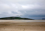 Flybe plane taking off from sandy airstrip Isle of Barra airport, Barra, Outer Hebrides, Scotland, UK