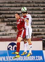 Matt Delicate (7) of the Richmond Kickers goes up for a header with Conor Shanosky (17) of D.C. United during a third round match in the US Open Cup at City Stadium in Richmond, VA.  D.C. United advanced on penalty kicks after tying the Richmond Kickers, 0-0.