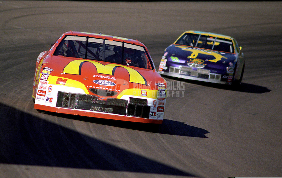 Nov. 1, 1997; Avondale, AZ, USA; NASCAR Winston Cup Series driver Bill Elliott leads Jimmy Spencer during the Dura Lube 500 at Phoenix International Raceway. Mandatory Credit: Mark J. Rebilas-