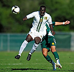 1 September 2009: University of Vermont Catamount midfielder/backfielder Yannick Lewis, a Sophomore from Toronto, Ontario, in action against the Siena College Saints at Centennial Field in Burlington, Vermont. The Saints edged out the Catamounts 1-0. Mandatory Photo Credit: Ed Wolfstein Photo