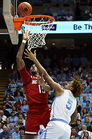 CHAPEL HILL, NC - FEBRUARY 25: Manny Bates #15 of North Carolina State University shoots over Armando Bacot #5 of the University of North Carolina during a game between NC State and North Carolina at Dean E. Smith Center on February 25, 2020 in Chapel Hill, North Carolina.