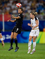 USWNT midfielder (5) Lindsay Tarpley goes up for a header against  New Zealand forward (9) Amber Hearn while playing at Wulihe Stadium.  The USWNT defeated New Zealand, 4-0, during the 2008 Beijing Olympics in Shenyang, China.  With the win, the USWNT won group G and advanced to the semifinals.