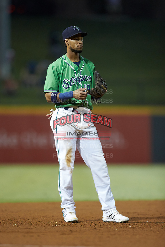 Gwinnett Stripers third baseman Pedro Florimon (18) on defense against the Scranton/Wilkes-Barre RailRiders at Coolray Field on August 16, 2019 in Lawrenceville, Georgia. The Stripers defeated the RailRiders 5-2. (Brian Westerholt/Four Seam Images)