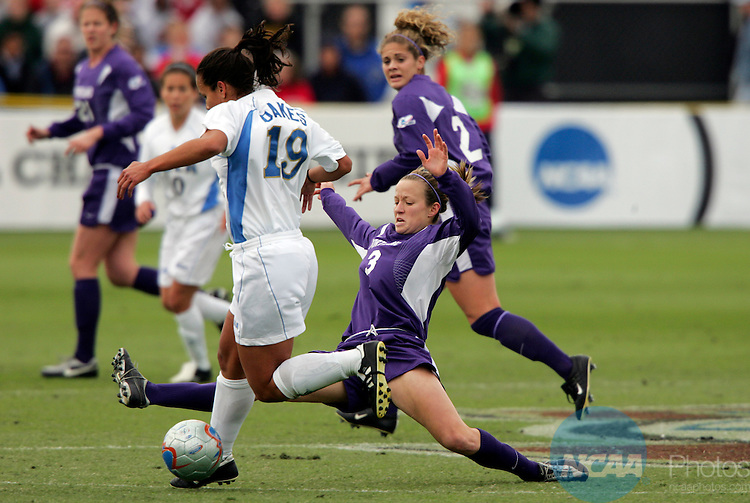 04 DEC 2005:  Megan Rapinoe (3) of the University of Portland dives for the ball against Jill Oakes (19) of the University of California Los Angeles in the Division I Women's Soccer Championship held at Aggie Soccer Stadium on the campus of Texas A&M in College Station, TX.  Portland defeated the University of California Los Angeles 4-0 to win the national title.   Rodolfo Gonzalez/NCAA Photos