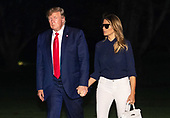 United States President Donald J. Trump and first lady Melania Trump hold hands as they return to the White House after attending the G7 Summit in Paris, on August 26, 2019 in Washington, DC. <br /> Credit: Kevin Dietsch / Pool via CNP