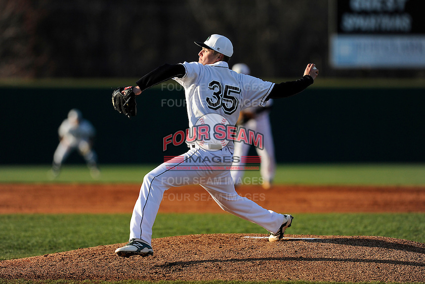 Starting pitcher Zach Mitchell (35) of the University of South Carolina Upstate Spartans delivers in a game against the UNC Asheville Bulldogs on Tuesday, March, 25, 2014, at Cleveland S. Harley Park in Spartanburg, South Carolina. (Tom Priddy/Four Seam Images)