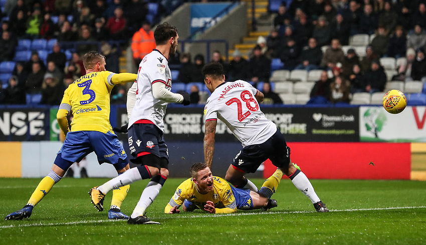Bolton Wanderers' Josh Magennis competing with Leeds United's Adam Forshaw<br /> <br /> Photographer Andrew Kearns/CameraSport<br /> <br /> The EFL Sky Bet Championship - Bolton Wanderers v Leeds United - Saturday 15th December 2018 - University of Bolton Stadium - Bolton<br /> <br /> World Copyright © 2018 CameraSport. All rights reserved. 43 Linden Ave. Countesthorpe. Leicester. England. LE8 5PG - Tel: +44 (0) 116 277 4147 - admin@camerasport.com - www.camerasport.com