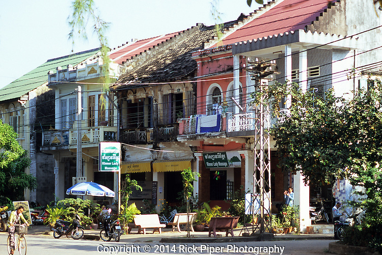 Old French colonial buildings on the riverfront road, Kampot, Cambodia.