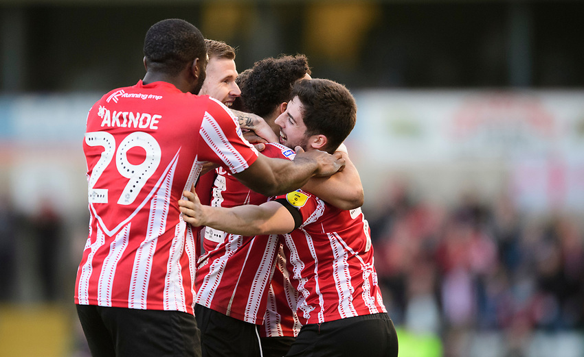 Lincoln City's Bruno Andrade, third in from left, celebrates scoring his side's second goal with team-mates, from left, John Akinde, Michael O'Connor and Tom Pett<br /> <br /> Photographer Chris Vaughan/CameraSport<br /> <br /> The EFL Sky Bet League Two - Lincoln City v Stevenage - Saturday 16th February 2019 - Sincil Bank - Lincoln<br /> <br /> World Copyright © 2019 CameraSport. All rights reserved. 43 Linden Ave. Countesthorpe. Leicester. England. LE8 5PG - Tel: +44 (0) 116 277 4147 - admin@camerasport.com - www.camerasport.com