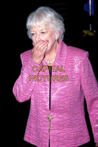 """JUNE WHITFIELD.at the """"Calendar Girls"""" Premiere, Leicester Square.pink jacket, printed, embroidered, brooch, hand over mouth, half length, half-length.www.capitalpictures.com.sales@capitalpictures.com.© Capital Pictures"""