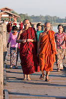 Myanmar, Burma, Mandalay.  Buddhist Monks on the U Bein Bridge, Amarapura.