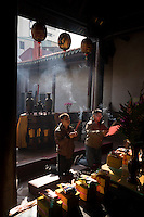 Local residents pray at the State Temple of the Martial God, also called the Tainan Sacrificial Rites Martial Temple in Tainan, Taiwan, 2015. This temple is dedicated to the deity Guan Gong, who is the most widely worshipped deity in Taiwan and mainland China.