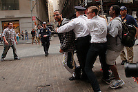 Occupy Wall Street member is pushing by a police officer during a weekly march called by every friday on Wall Street in New York, United States. 23/03/2012.  Photo by Kena Betancur / VIEWpress.