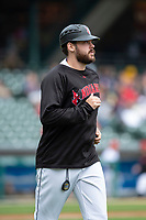 Indianapolis Indians Will Craig (25) coaches first base during an International League game against the Columbus Clippers on April 30, 2019 at Victory Field in Indianapolis, Indiana. Columbus defeated Indianapolis 7-6. (Zachary Lucy/Four Seam Images)