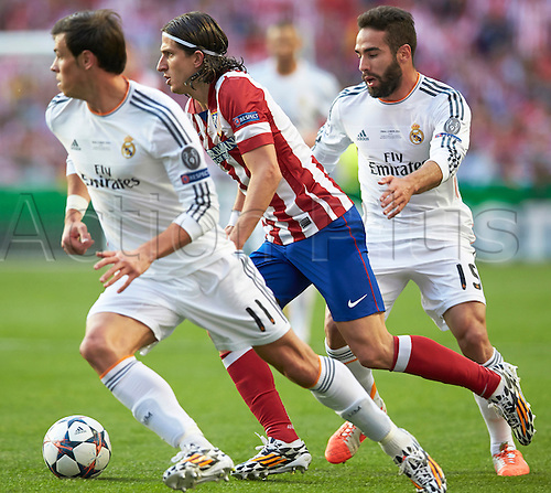 24.05.2014, Lisbon, Portugal. Defender Filipe Luis of Atletico Madrid (C) breaks away from Midfielder Defender Daniel Carvajal of Real Madrid (R) and Midfielder Gareth Bale of Real Madrid  during the UEFA Champions League final game between Real Madrid and Atletico Madrid at Sport Lisboa e Benfica Stadium, Lisbon, Portugal